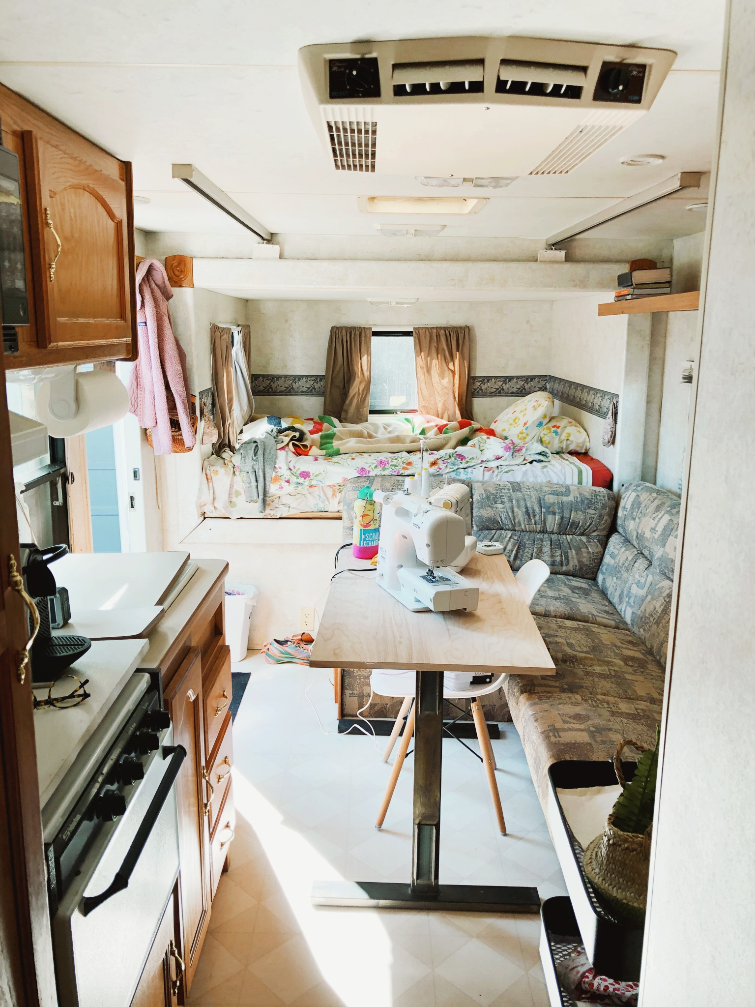 This is the view from the back of the RV looking out toward the door. The table is a bit tight during the day when I push it out to sew - but it works.