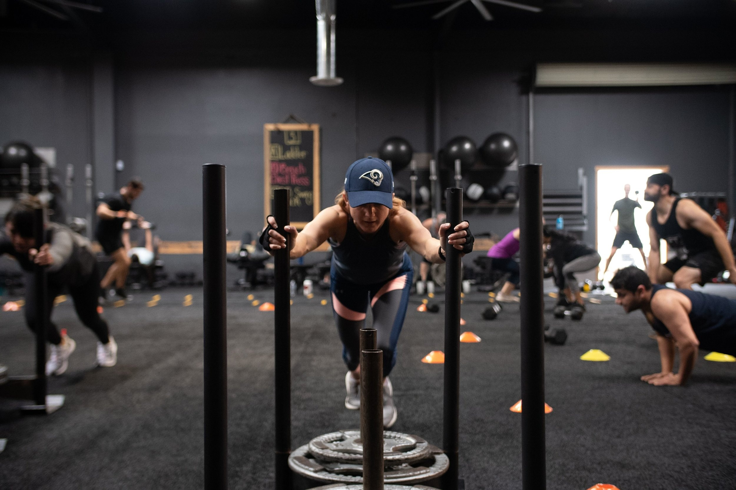 WORK Anywhere - WORK Anywhere is a carbon copy of the exact workouts we do each day in studio. Because of this, we suggest having access to the following pieces of equipment for this program: barbells, dumbbells, bands (or cable machines), mini bands, sleds, balls, gliders, and battle ropes.