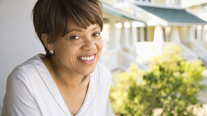 2044241 - african american middle aged woman smiling at viewer outside home.