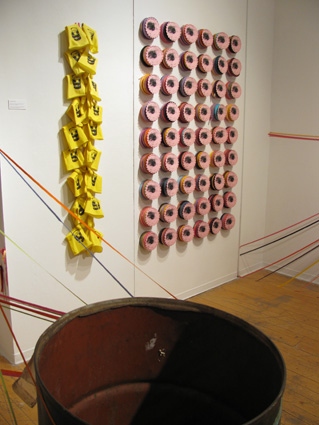 The 'Place Holders' are screen printed ribbon on scalloped card. These were made so that once the ribbons went to the vacant lots for installation, there would not be vacancy in the corner of the gallery.