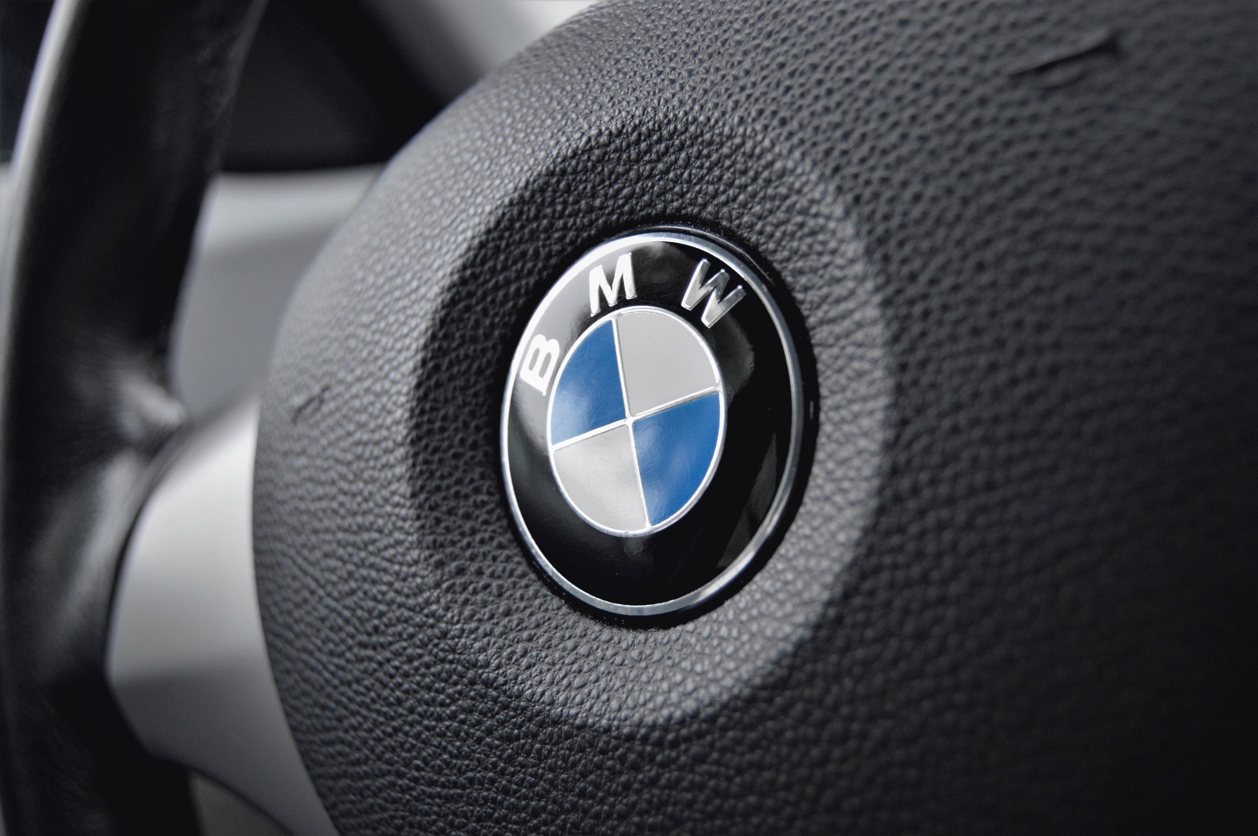 Canva - Black and Gray Bmw Steering Wheel.jpg