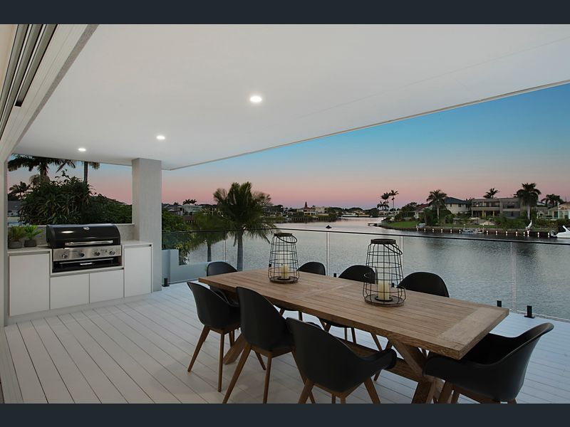 Modern waterfront living with white deck and built in BBQ Gold Coast Building and Renovations