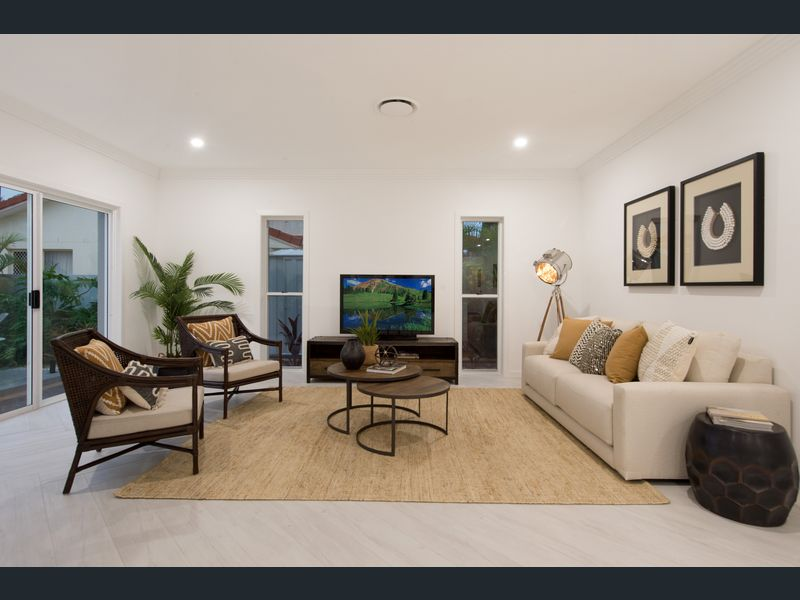 Modern boho living room with herringbone floors, Boho inspired styling