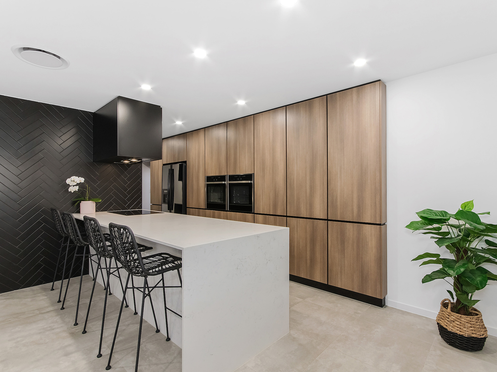 Modern luxury kitchen with marble bench tops and finger pull soft close cupboards