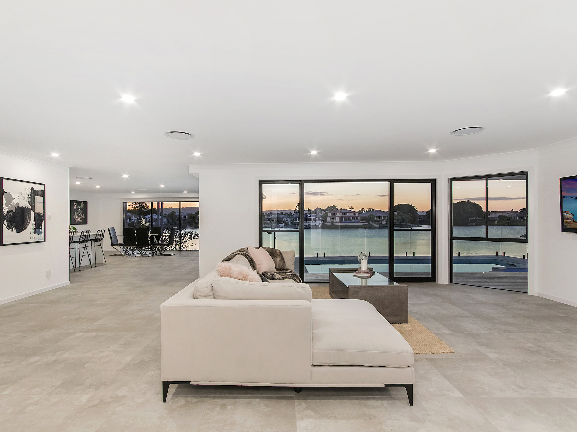 Open plan living with concrete tiles, minimalistic living area