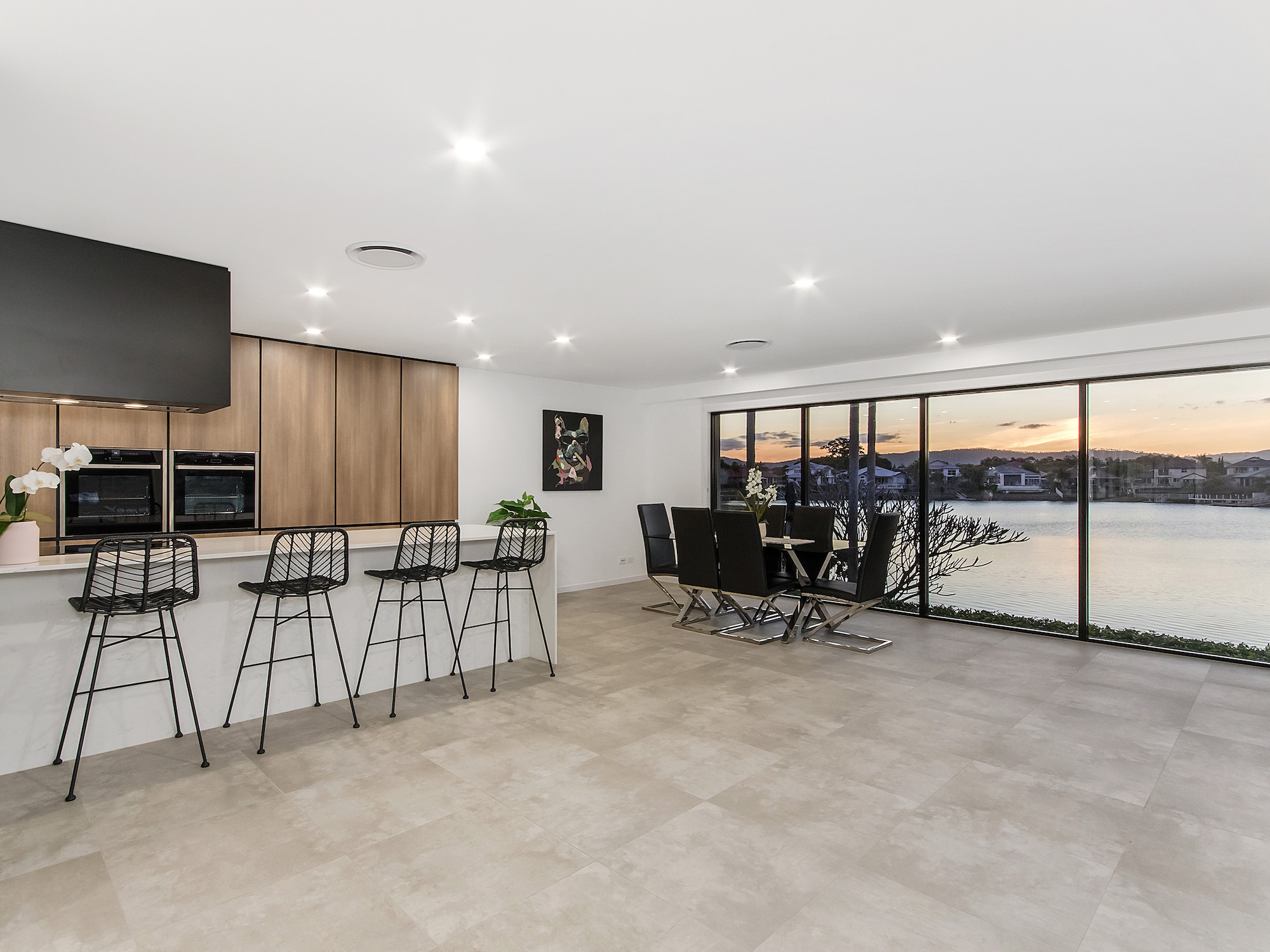 Modern galley style kitchen with hidden butlers panty and concrete tiles