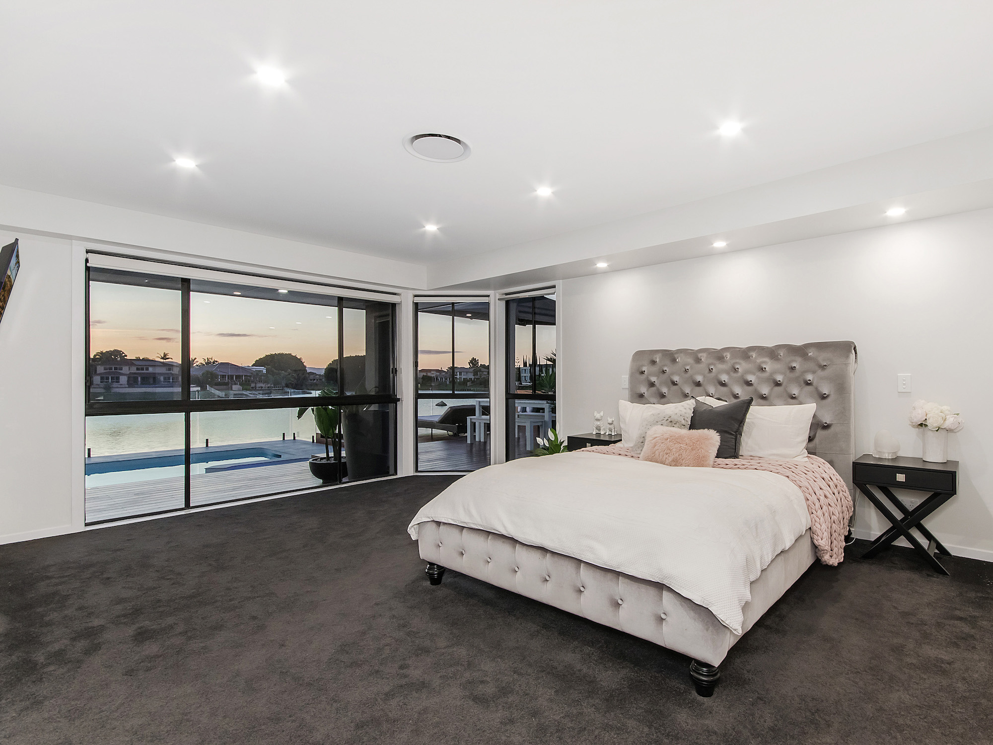 Master retreat with contemporary classic grey velvet bed
