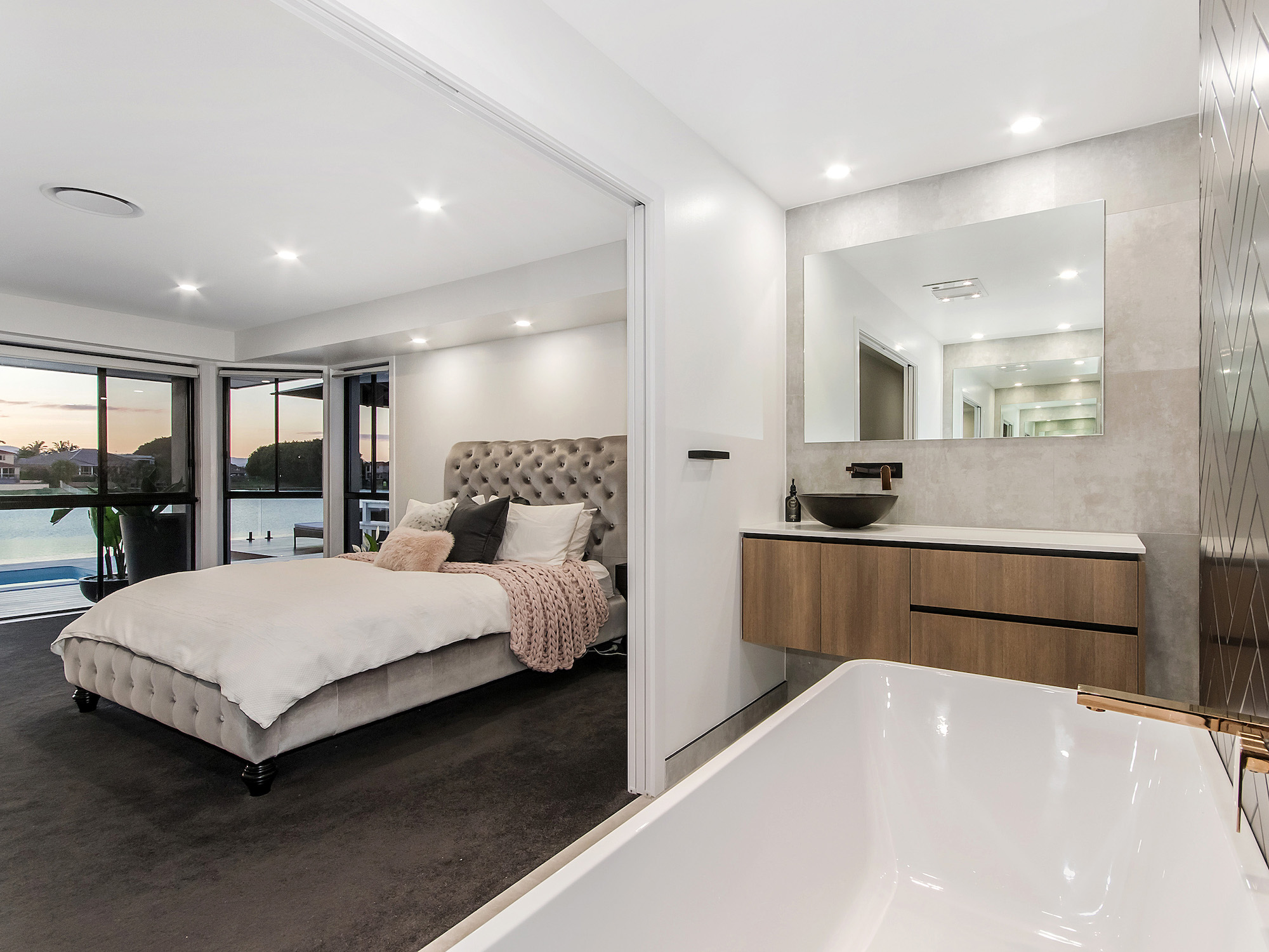 modern master suite with optional open bathroom and a bath with a view