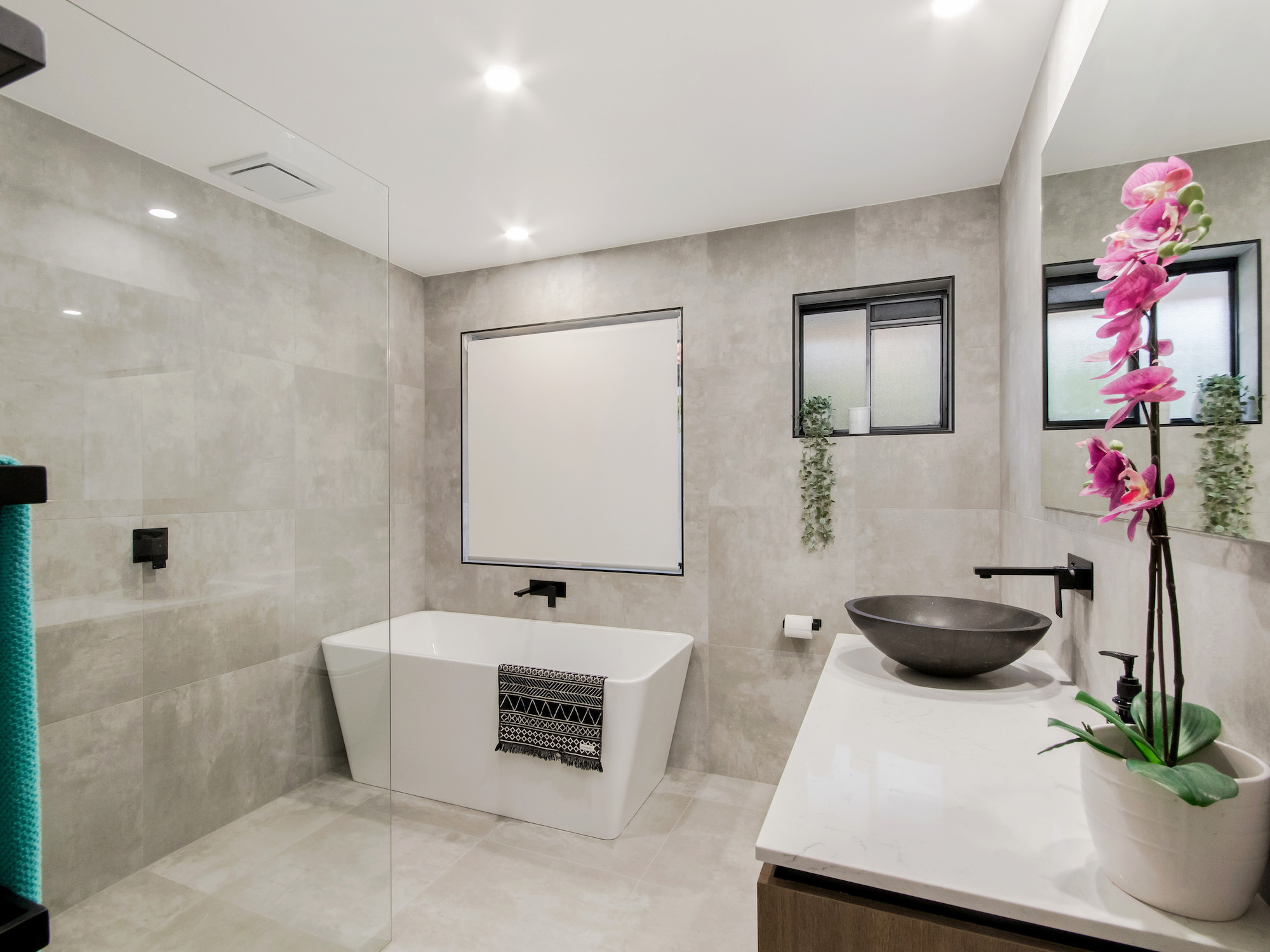 modern bathroom with concrete tiles and custom timber vanity