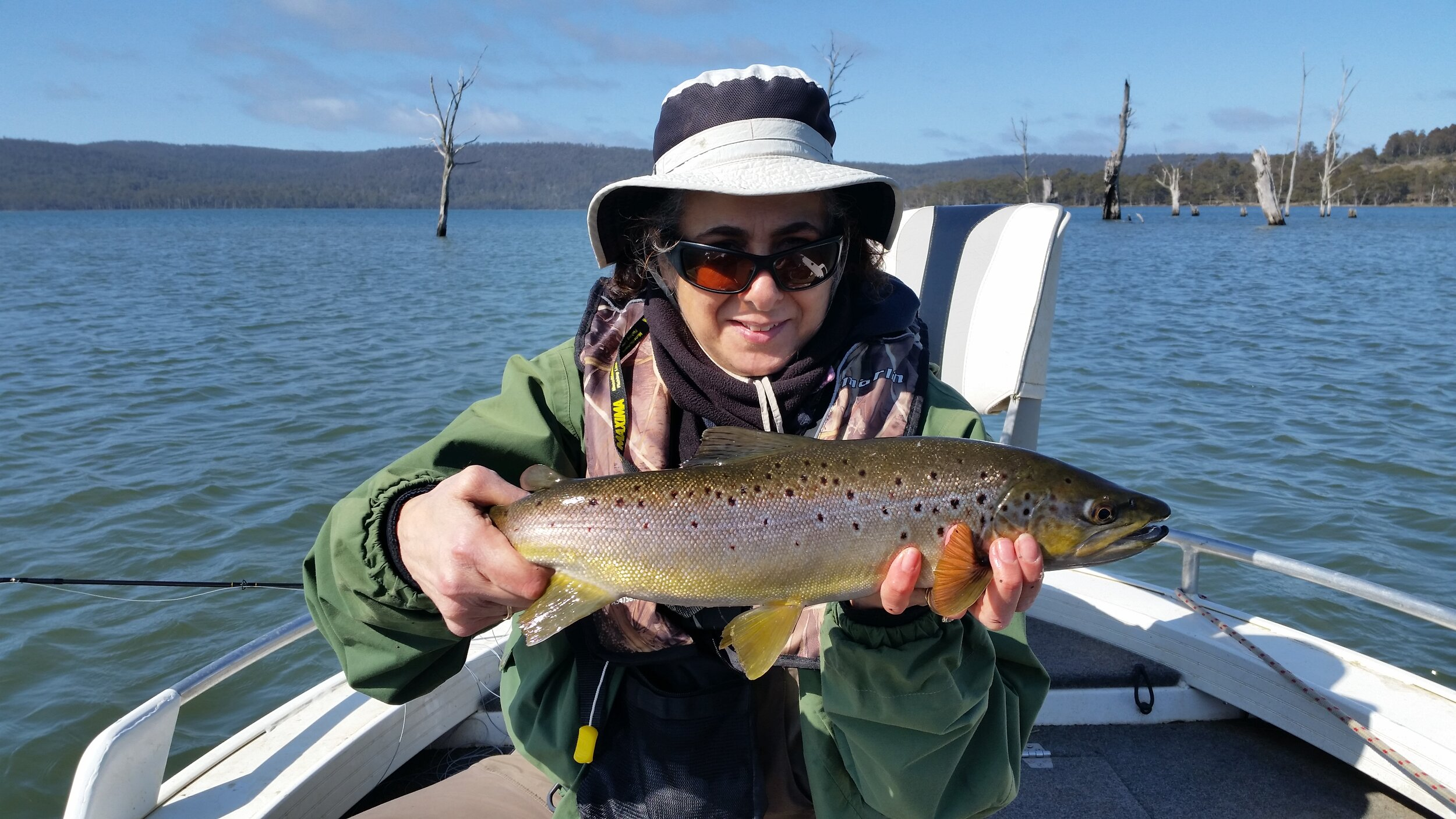 Anna with a really well conditioned Woods Lake brown trout taken on fly last weekend.