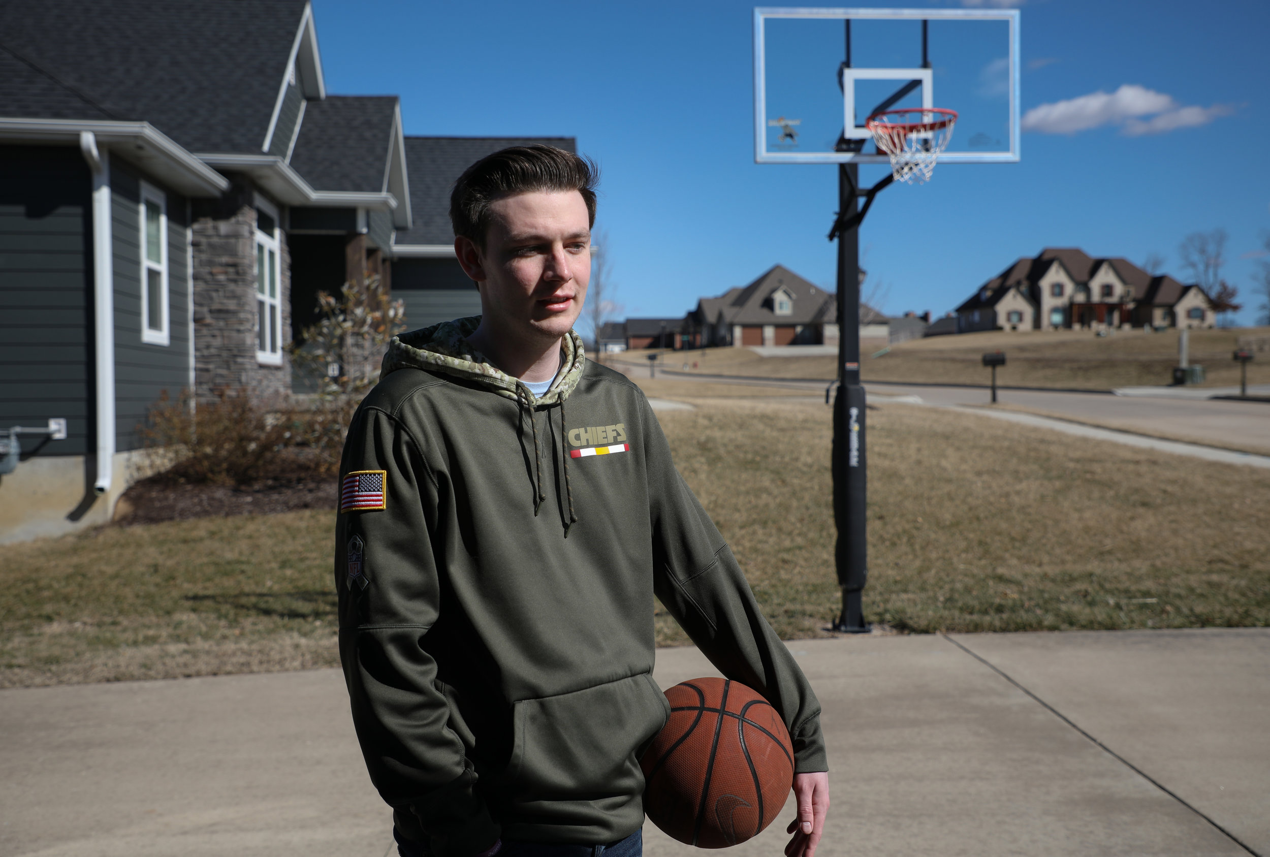 "Matt May takes a break after playing basketball on the driveway of his house on Friday, March 15, 2019, in Columbia, Missouri. A week ago, he was able to play a game of basketball and run up and down the court at the first time since he was done with treatment. ""That was such an incredible feeling to be able to do that again and just be another person on the court,"" May said."