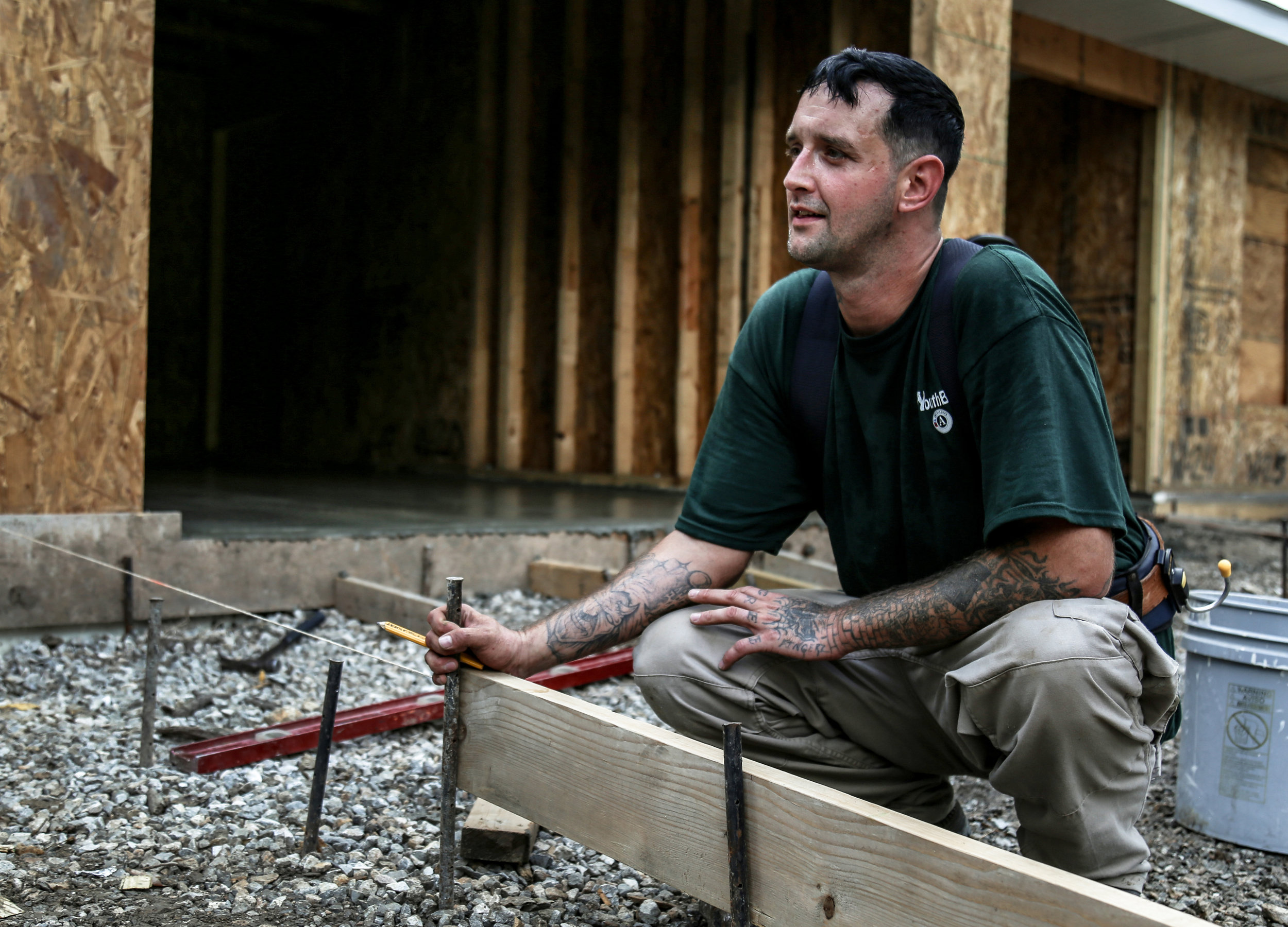 """Timothy Avey, 36, a construction student of Job Point, receives guidance on how to form the driveway before pouring concrete on Sept. 25 in Columbia, Missouri. After being incarcerated for six years, he went to Job Point for help to reenter the work force. """"I wanna be one of the best carpenters Job Point's ever seen,"""" said Avey."""
