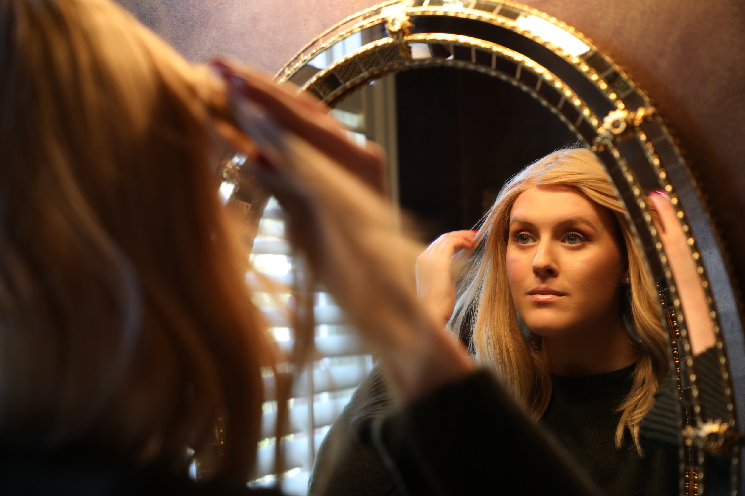 "Nicole Cummings looks herself in the mirror after wearing her wig on March 16, 2019, at her home in Kansas City, Missouri. Cummings was diagnosed with Stage 4 Hodgkin's Lymphoma at the age of 20. She began showing hair loss several weeks after treatment. Cummings said it was sad to see that coming at first, but she now views every hair strand as a defeated cancer cell. ""It means that the medicine is working. I'm getting rid of this cancer and it's not going to define me,"" she said."