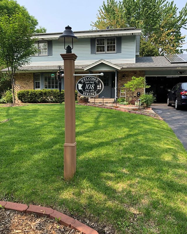 Low voltage, dark sky lamp post.  Cedar 4x4 underneath in concrete with a low maintenance sleeve.  Custom CNC house sign by lamppostsigns.net.