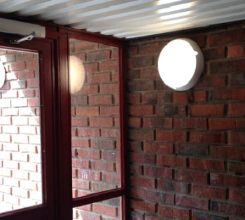 LED Polycarbonate Round Fixture Mounted as a Wall Sconce