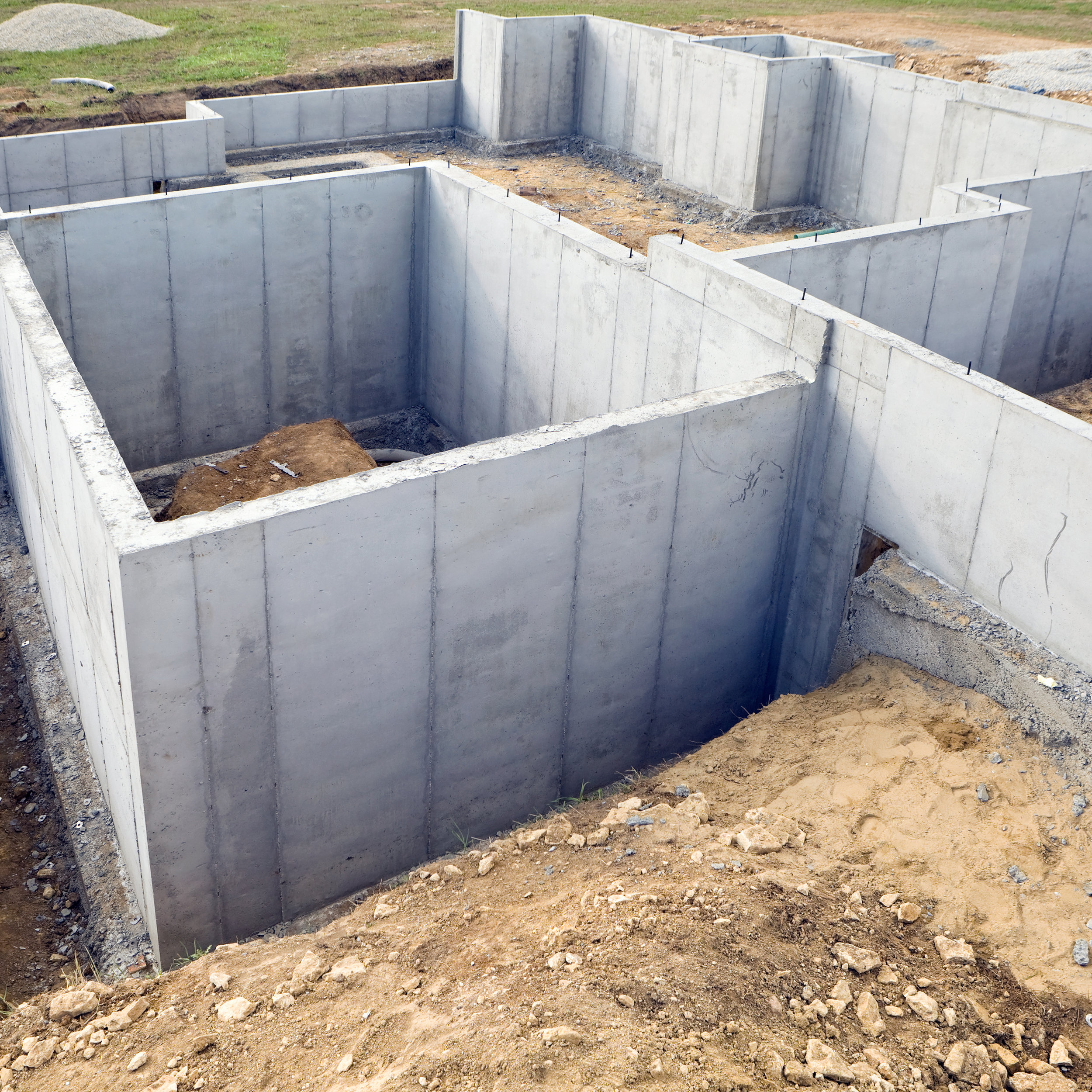 Foundation - Giesbrecht Buildings Inc. is very proud of our foundation work. We always strive to be perfectly accurate and to exceed industry standards.We pay particular attention to the MPa (Megapascal) of the concrete, which measures its compressive strength and how much pressure can be applied before it cracks or fails.If better flow is required during placement, we always add chemical additives instead of industry standard water. Water is known to decrease the durability of concrete over time.Although chemicals are slightly more expensive, they ensure the proper concrete strength recommended by engineers.