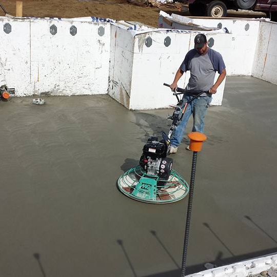 Concrete - The GBI crawlspace is far above industry standards: a 2.5 inch concrete slab poured over a continuous ground seal, which means no curbs penetrating through the seal.We ensure that the slab and vapor barrier sit directly on top of the footing for bearing walls.After placement, the finish is blackened with a power trowel for a smooth, polished floor. This allows for easy cleaning and the easy sliding of cardboard boxes, and we are happy to provide a complimentary plywood creeper to move heavy boxes around your crawlspace on move in day.The polished crawl floor also allows the GBI staff to properly clean all construction dust from the space prior to occupation, as well as making cleaning easier down the road.The polished floor is also ready for an optional concrete sealer to be applied.