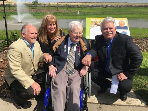 Gordon King, a 99-year-old Second World War veteran who dodged  death several times during war, is honoured on Saturday, June 22 as the City unveils streets and a pond named after him in the new Keswick subdivision. King is surrounded by three of his children: Richard (left), Cathy, and Chris (right).