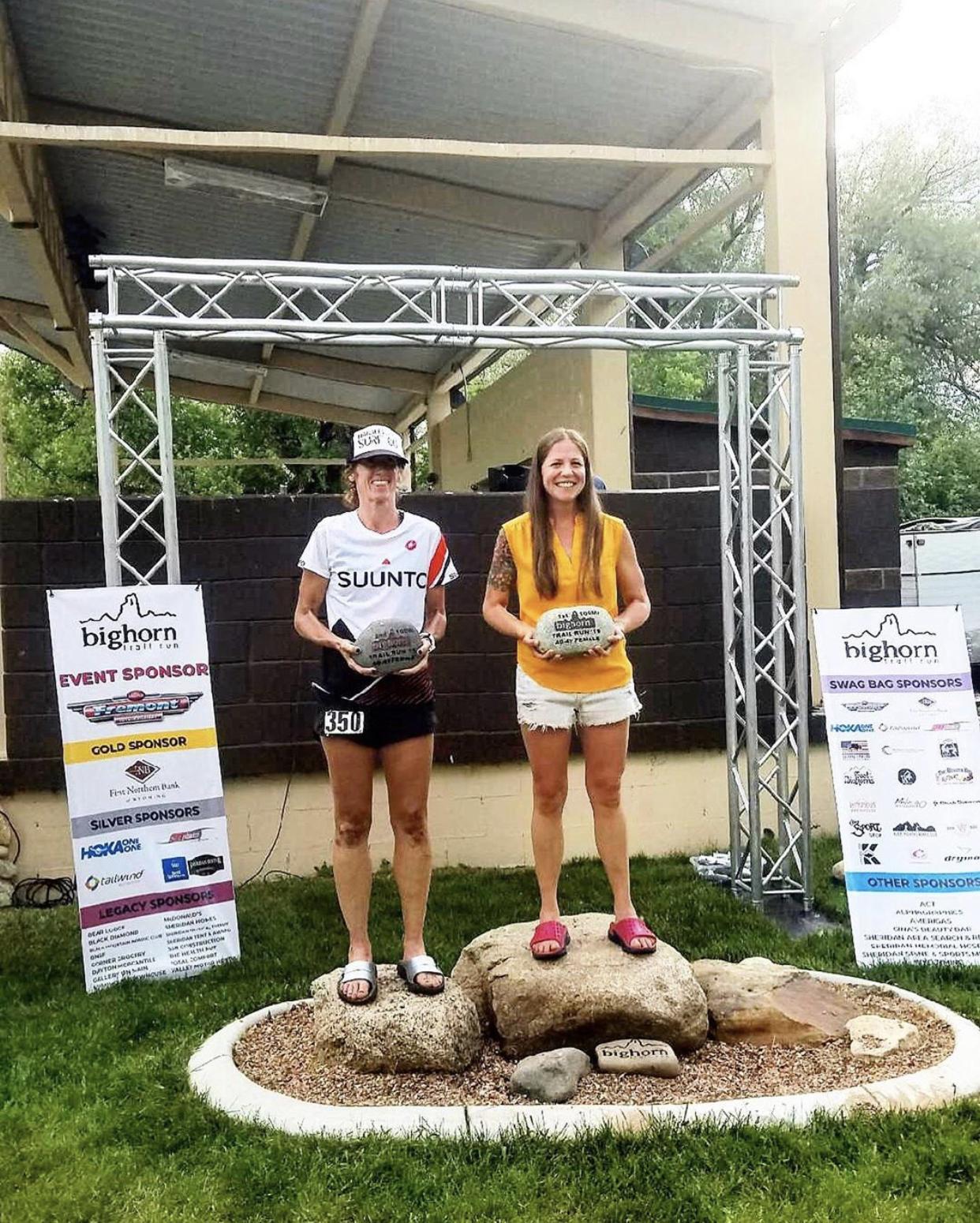 Tara wearing her 100 mile podium kicks - Oofos recovery sandals