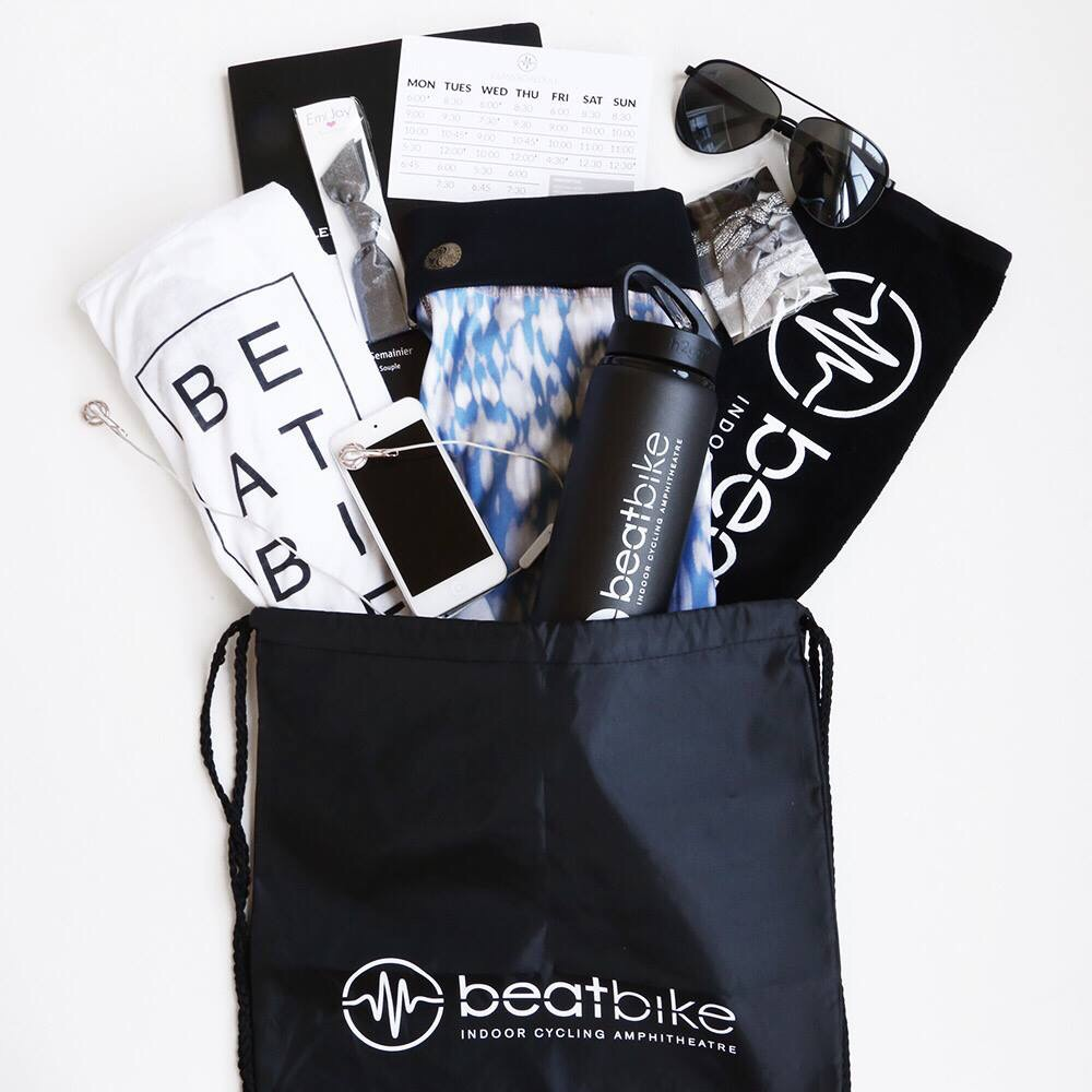 Reusable Bag - Having a multi-purpose bag is always a good idea to keep with you. You can use it to keep all your sweaty clothes if you take a shower after class, or for picking up groceries at the Whole Foods below Beatbike after class!