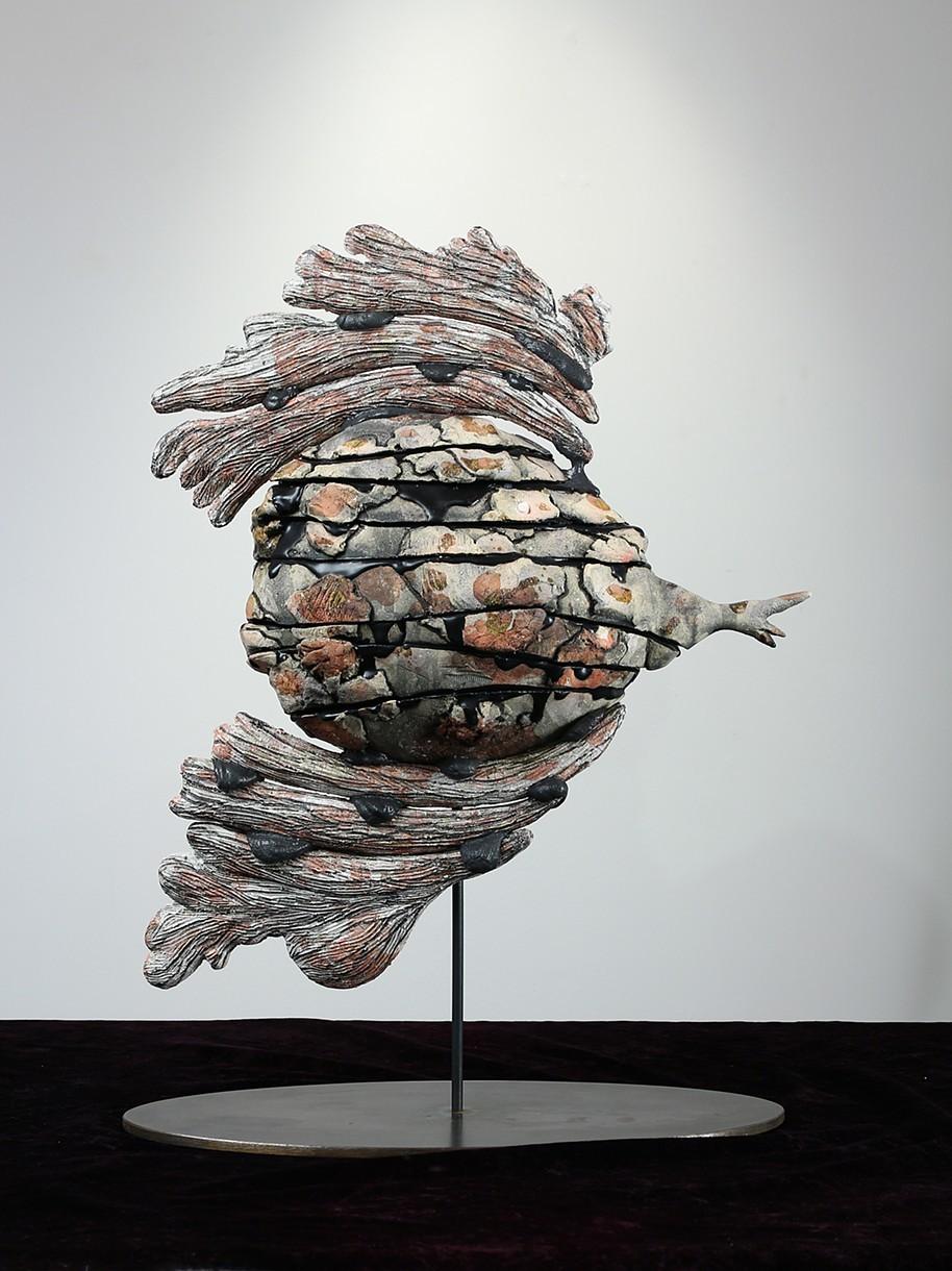 "Iraq    Ceramic, glue, metal base  17""h. 8""w. x 7""d."