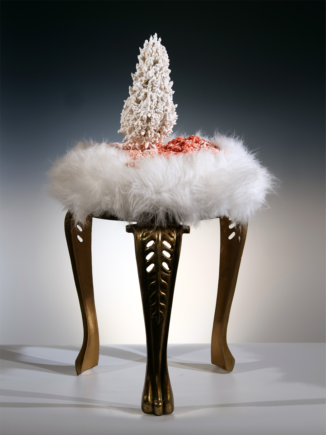"""Island of Resilience: comfort, humor, nature, and community    2019  porcelain, faux fur, metal  21""""w. x 33""""h. x 21""""d."""