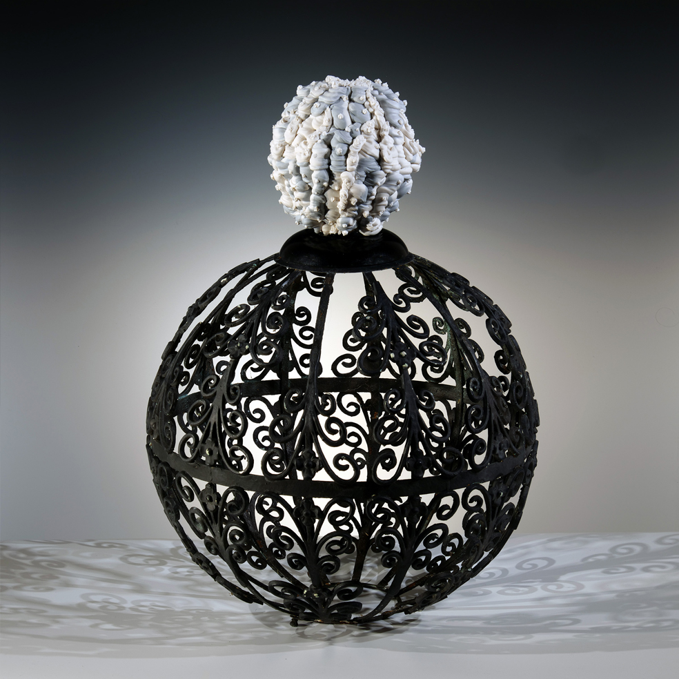"""Island of Resilience: internal gardening and shadow work    2019  porcelain, metal, plastic  27""""h. x 20""""d. x 20""""l."""