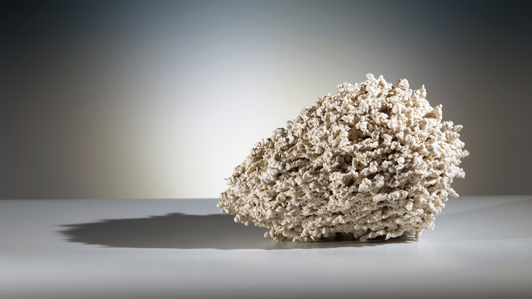 """Island of Resilience: meteoroid    2018  porcelain  15""""l. x 9""""d. x 9""""h."""