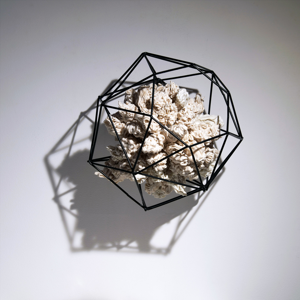 """We are all in this together    2019  porcelain, foam, nails, glue, metal  9""""w. x 11""""h. x 9""""d."""