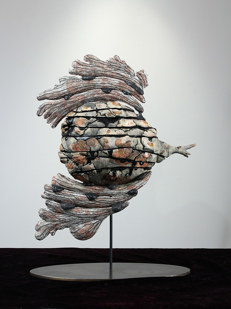 "Iraq    ceramic, glue, metal base  17""h. 8""w. x 7""d.  $2000"