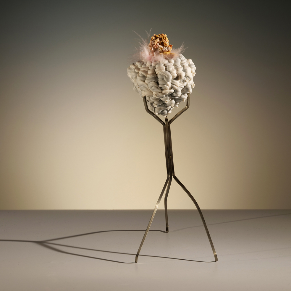 """Island of Resilience: ritual, fantasy, and organic growth  porcelain, feathers, metal  7""""w. x 4""""d. 3""""h  $500"""
