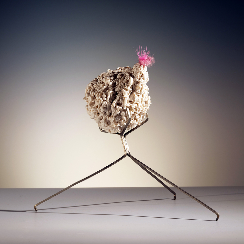 """Island of Resilience: catapulting away when necessary  porcelain, feathers, metal, and fiber  13""""w. x 11h. 10d.  $500"""