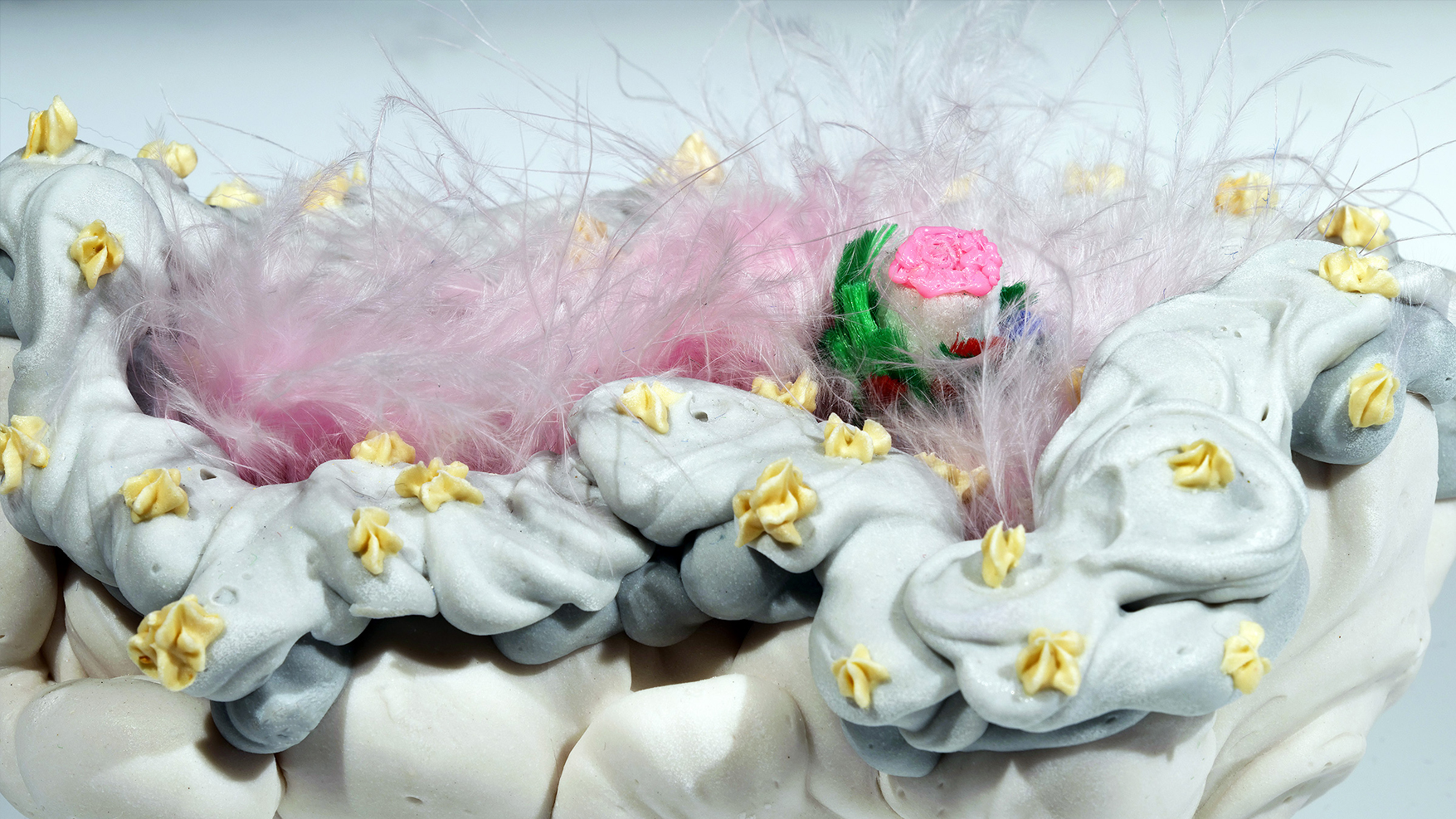 """Island of Resilience: Nurturing hybrids (detail)  porcelain, rope, feathers, plastic  7""""w. x 4""""d. 3""""h  $500"""