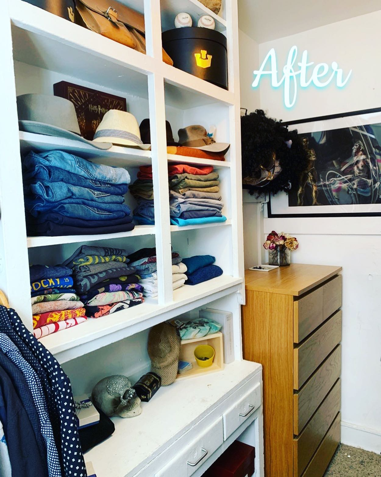 Closet Refresh, Capitol Hill - This was such a fun closet makeover! My client needed a freshen up for himself and his husband. Believe it or not, they SHARE A WARDROBE! If that isn't #marriagegoals, I don't know what is😂 These two have glorious clothes, and the coolest apartment in one of Denver's historic districts. They also live part of the year in Aspen, CO and needed a system that was easy and efficient for moving their clothes twice a year. The built-ins are divine, and the tall ceilings make this closet bright and cheerful. My clients had keepsakes and memorabilia to display as well, which adds the the charm of this closet. This freshen up was fun AND effective. Now, if I could just borrow from their costume trunk....