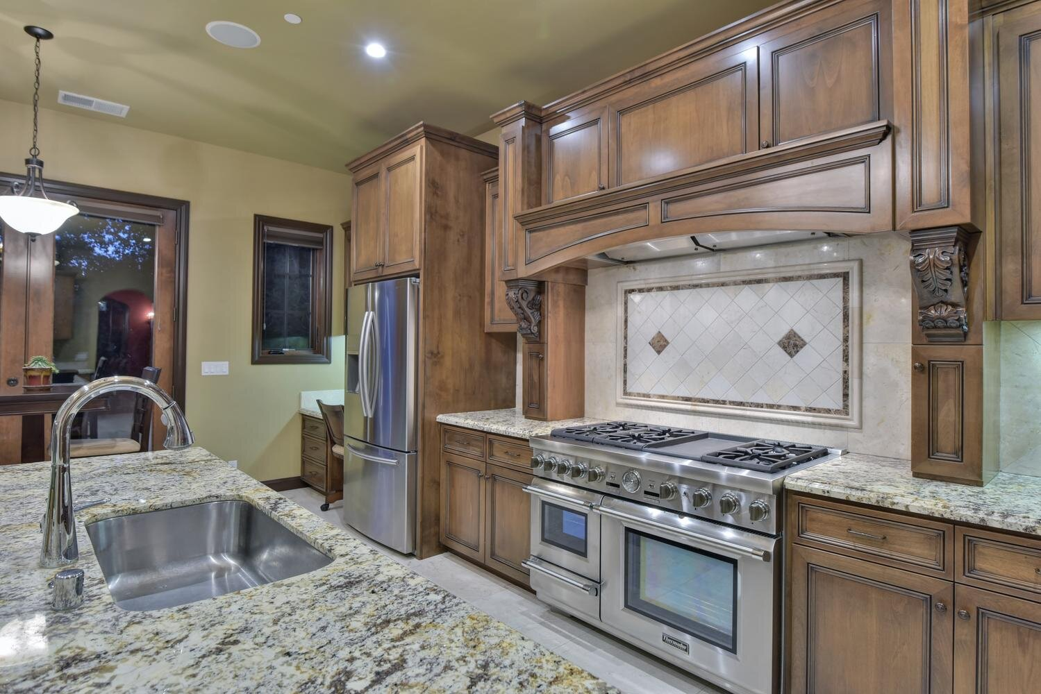 16021 Winterbrook Rd Los Gatos-large-019-030-Kitchen Sink and Stove View-1499x1000-72dpi.jpg