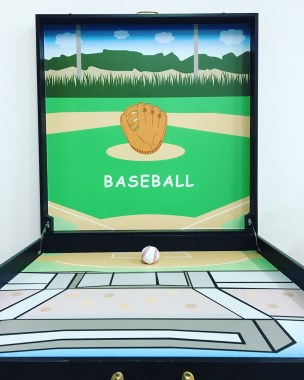 Throw the baseball onto the board and see where it lands on the bound on the different score patches!
