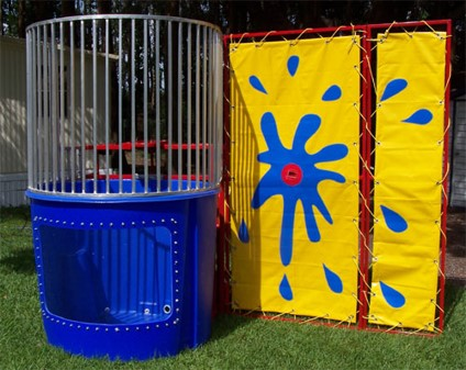Dunk Machine for family fun! Put someone on to the seat above the water and try to get them wet by throwing the balls at the target!