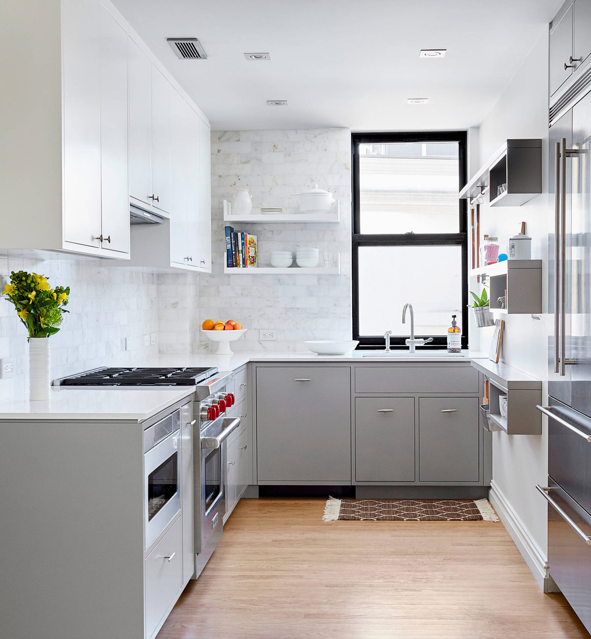 Grey-and-Stainless-Steel-Kitchen-White-Counters-and-Mix-Backsplash.jpg