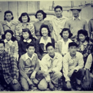"""Pictured center is my grandmother sitting among a group of Japanese American teens while incarcerated at Topaz Internment Camp during WWII. On this Day of Remembrance, I think about her and my grandfather who came of age behind barbed wire, having been put there in the name of """"national security"""". As I think about them on this particular DOR, I also pledge not only to continue telling the stories of my people but also stand up against today's detention centers, mass incarceration, racist bans, deportations, militarized border, and xenophobic government. Never again is now. ***** """"On this 77th anniversary of Executive Order 9066, we do more than just remember the Presidential order that enabled the incarceration of nearly 120,000 Japanese and Japanese Americans.  We remember the racism and xenophobia against Japanese and other Asian communities that led up to the issuance of Executive Order 9066.  We remember how our government lied about the national security threat that we imposed, simply because of our Japanese heritage.  We remember how our community leaders were targeted by the FBI because of the groups they were in, members of Buddhist and Shinto churches, martial arts instructors, Japanese language school teachers, and many others.  We remember how the census was used against us to identify who was Japanese and needed to be rounded up and imprisoned.  Most of all, we remember the lives impacted: the dreams ended, the families torn apart, the lives destroyed."""" (JACL)  #dayofremembrance #neveragainisnow #japaneseamerican #jacl"""