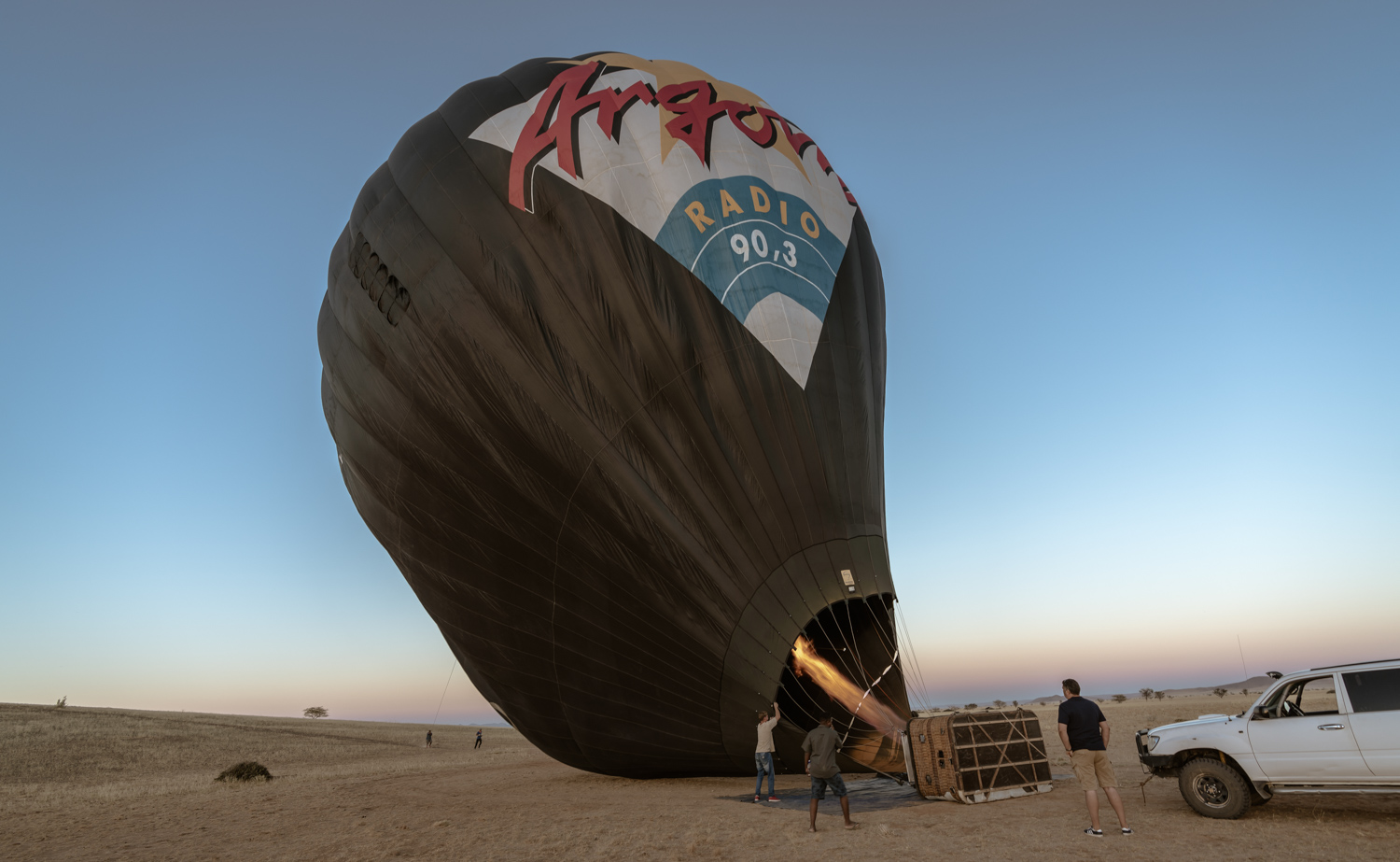 Preparing the balloon  - Solitaire, 15.2.2019, 6:15 AM -Samawati Hot Air Ballooning is based in Tsondab Valley or the Solitaire Area in Namibia. Photo: Roland Steffen - Sony A7r III, Sony FE 16-35 mm F/2.8 GM