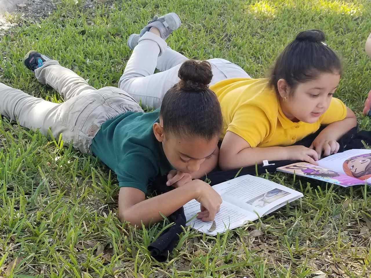 reading in grass.jpg