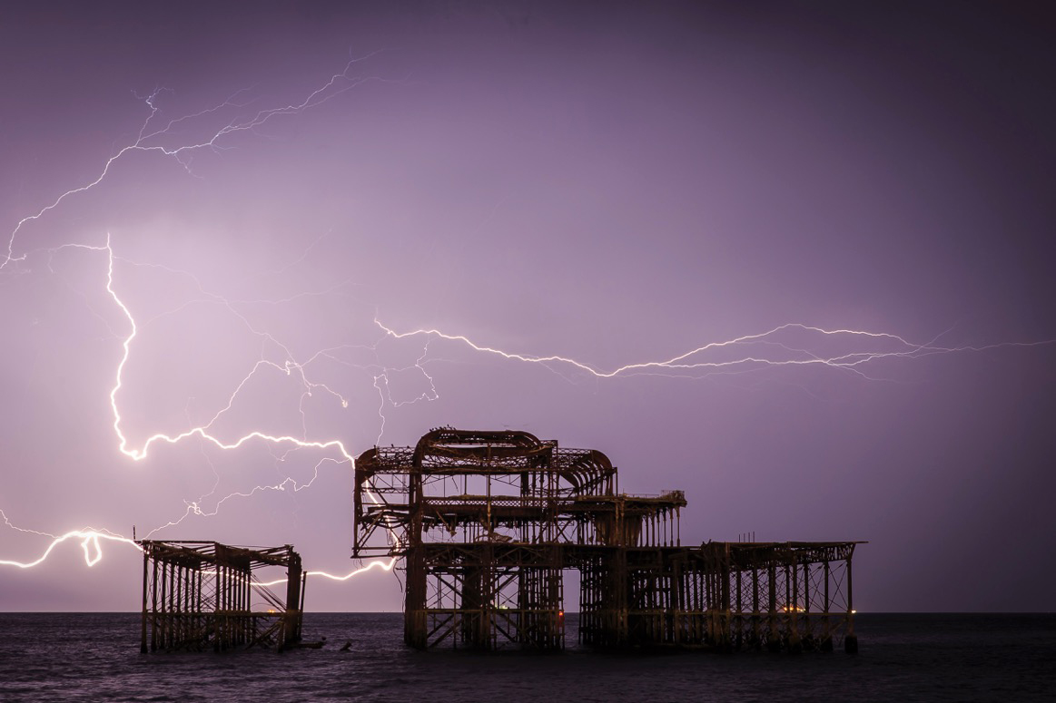 Lightning lights up the sky behind Brighton�s iconic burned-out West Pier as a huge electrical storm shakes the South Coast town.Photo by Adam Gerrard  13 September 2017