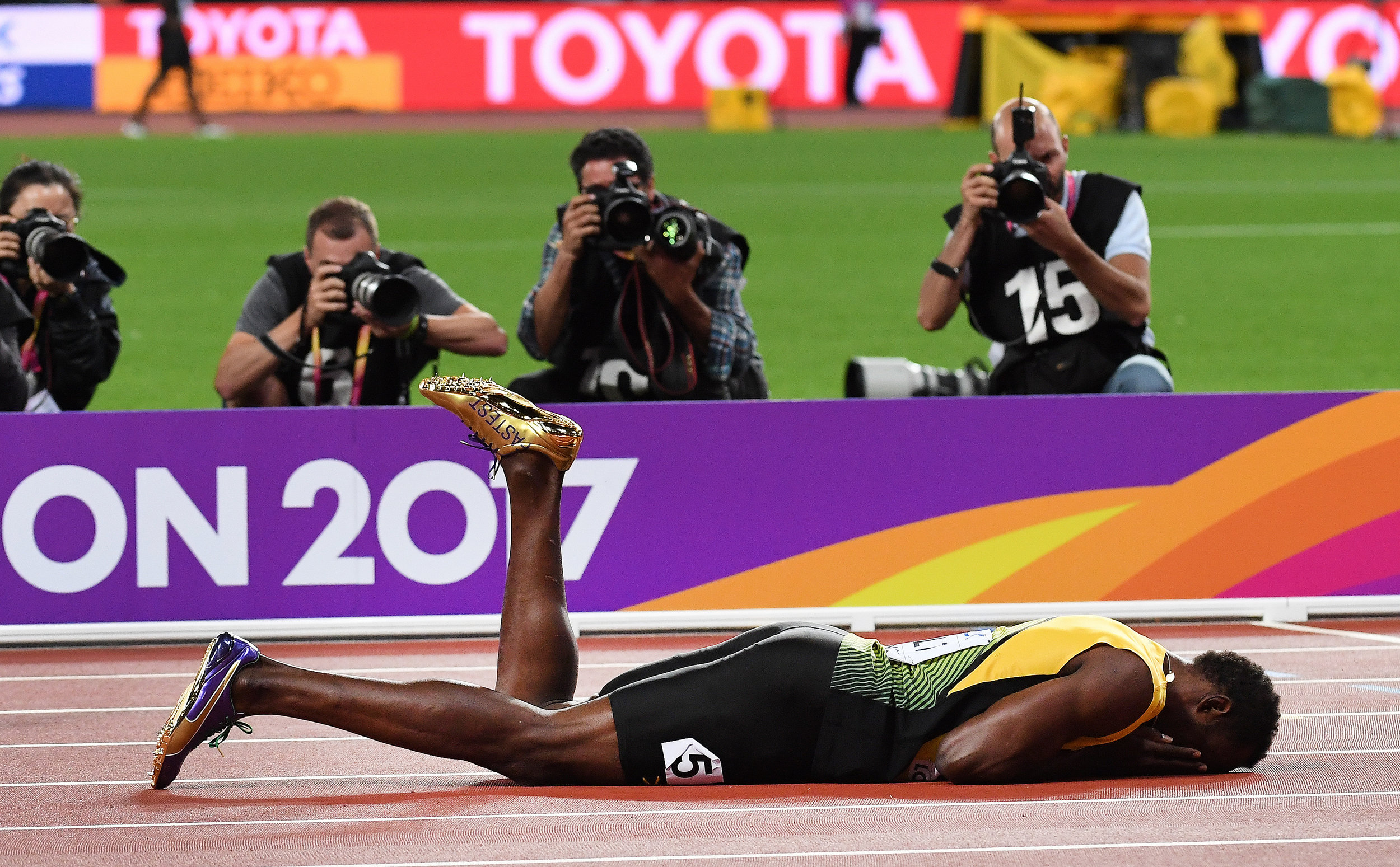 Usain Bolt face down on the track after sustaining an injury during the men's 4x100m Relay final at the 2017 IAAF World Championships at the London Stadium.Photo by Andy Rain  12 August 2017