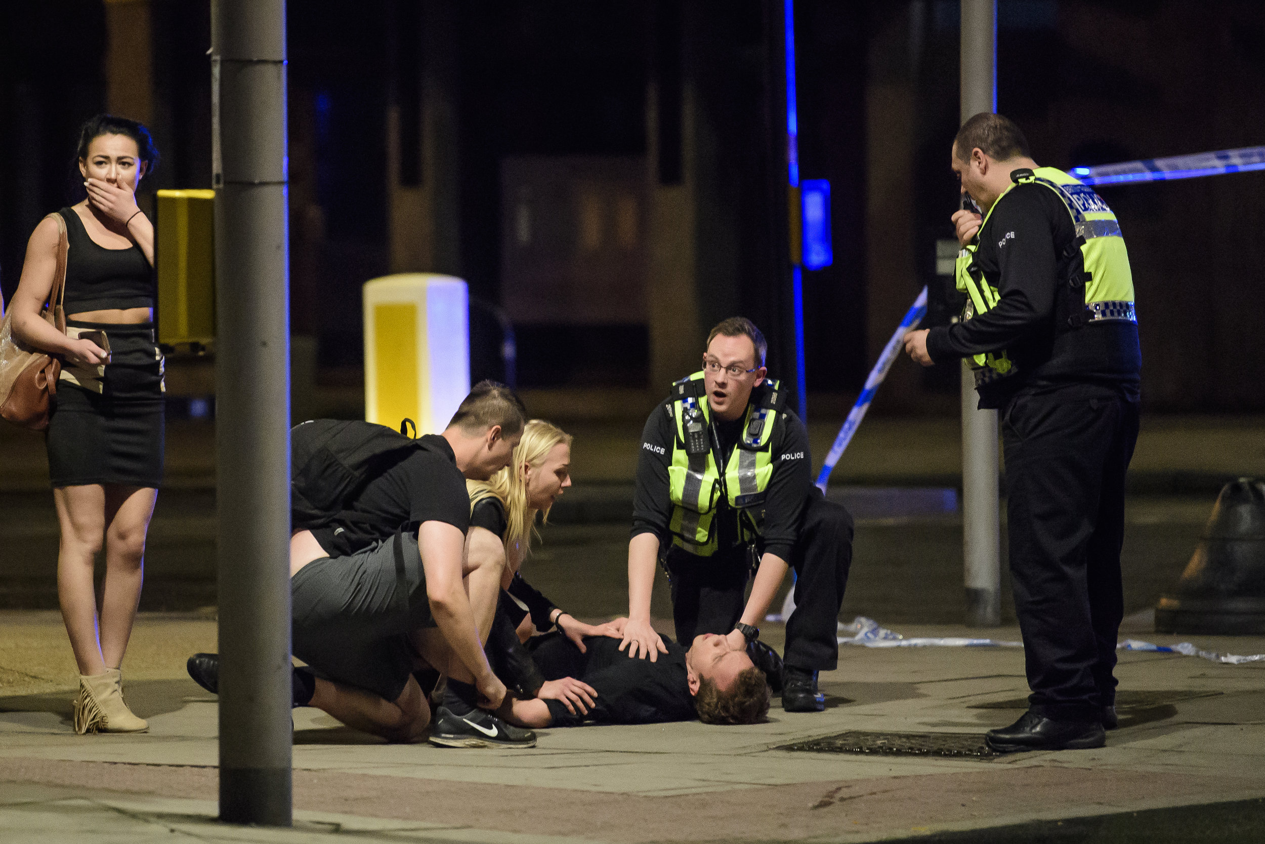 Police officers tend to a man collapsed on the floor near London Bridge, after a vehicle had been deliberately driven at pedestrians crossing the bridge during a terrorist incident.Photo by Ben Cawthra  03 June 2017