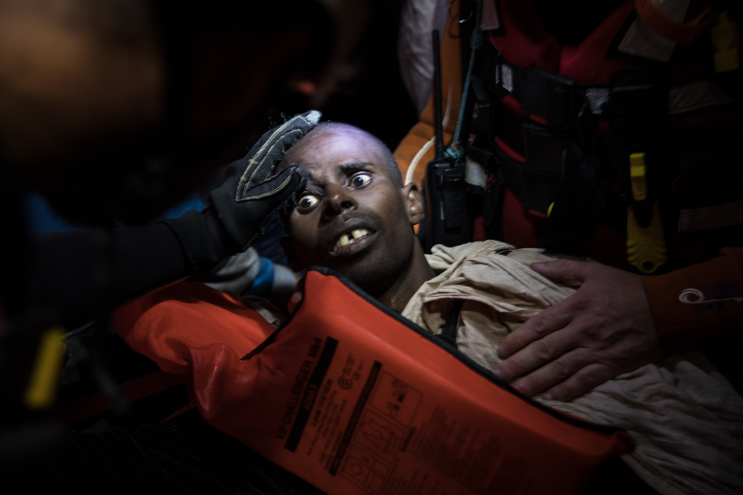 Members of Migrant Offshore Aid Station and the Red Cross try to keep a man alive. He was believed to be suffering from breathing fumes from a boat engine he was travelling on off the coast of Pozzollo Italy.Photo by Dan Kitwood  22 November 2016