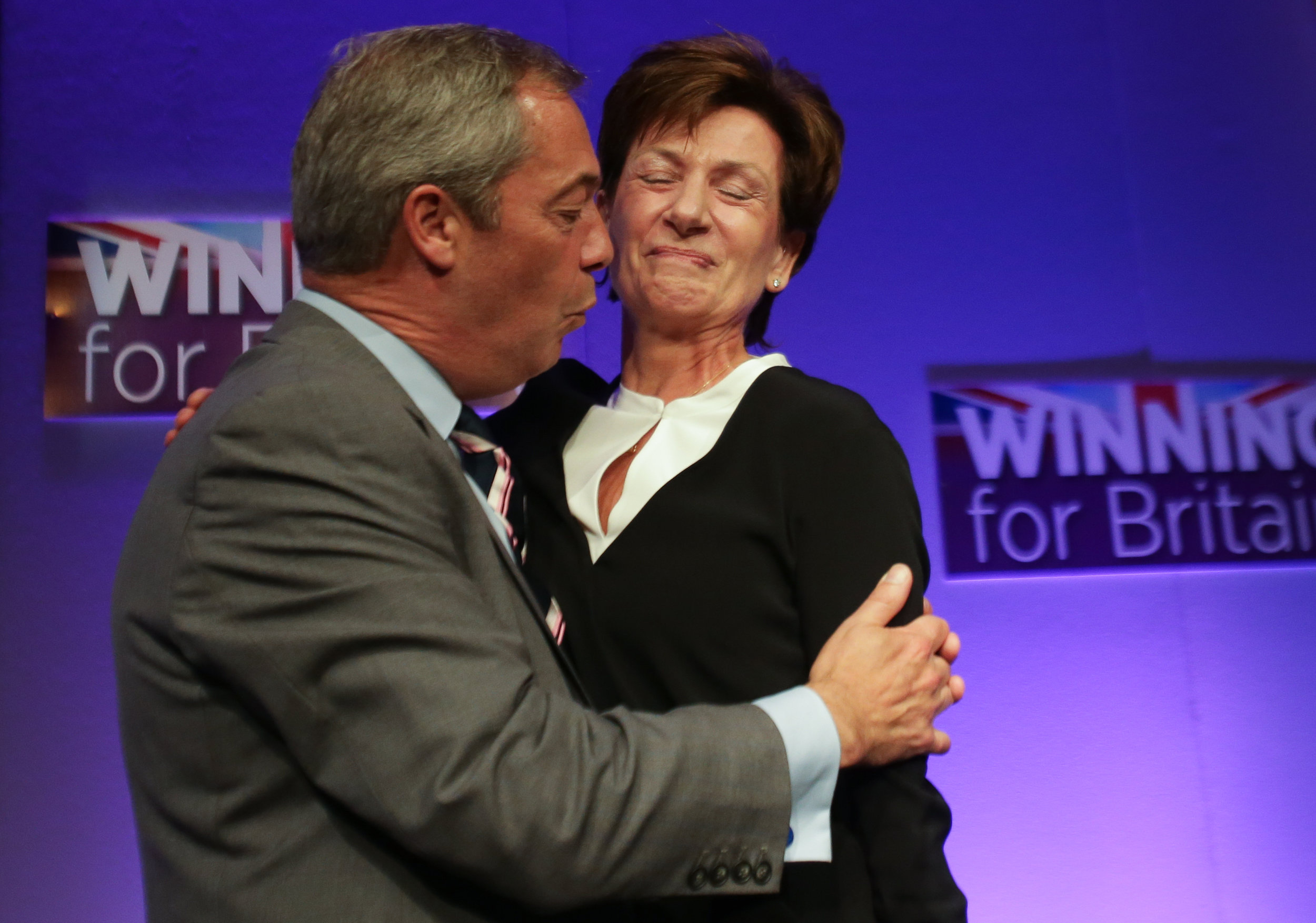 Outgoing UKIP leader Nigel Farage embraces his successor Diane James as she is introduced at the party�s Autumn Conference in Bournemouth.Photo by Daniel Leal-Olivas  16 September 2016