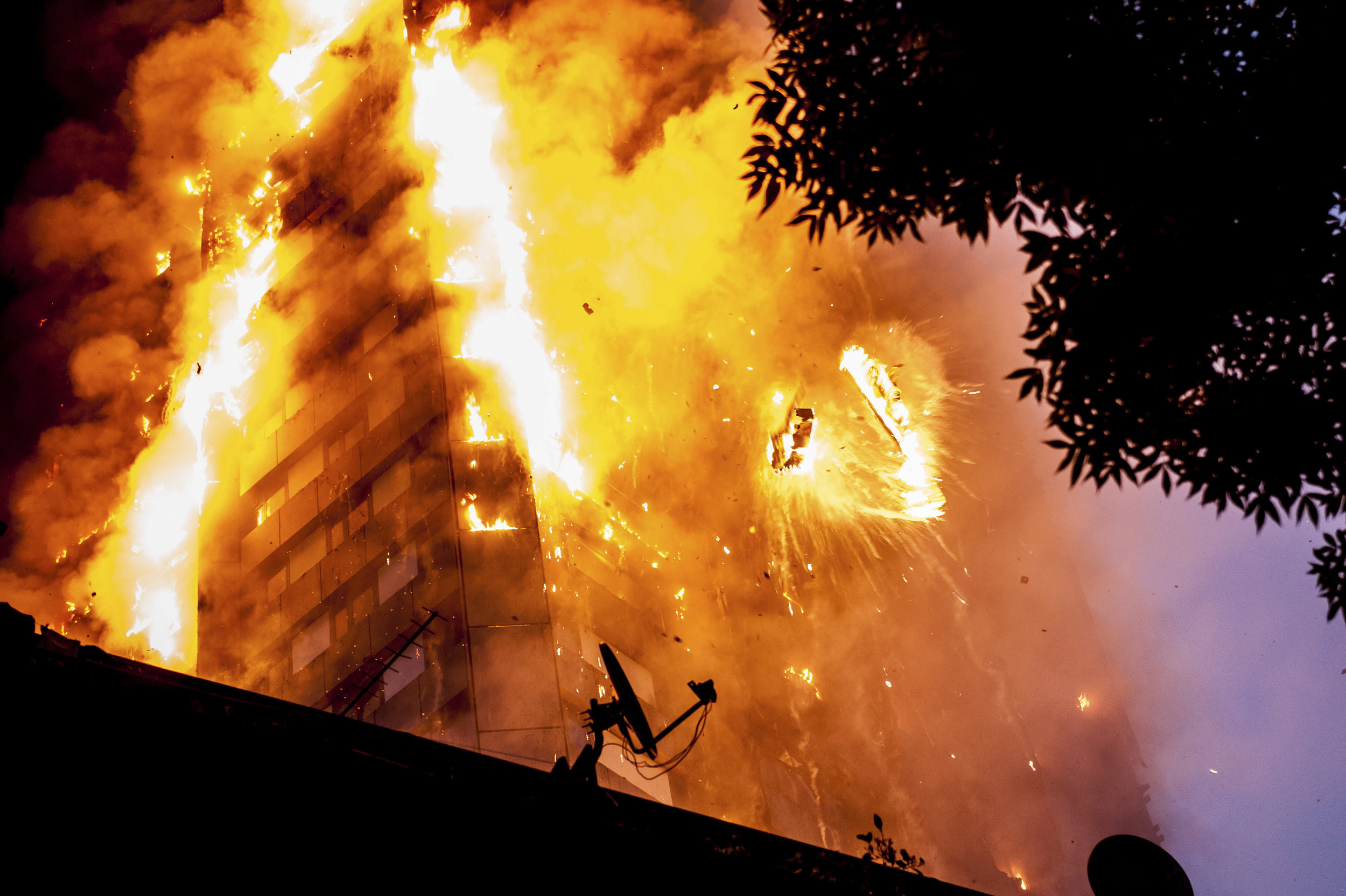 The fire at Grenfell Tower in the Royal Borough of Kensington and Chelsea engulfs the 24-storey building as 200 firefighters and 40 fire engines attend the scene and attempt to rescue as many residents as possible.Photo by Guilhem Baker  14 June 2017