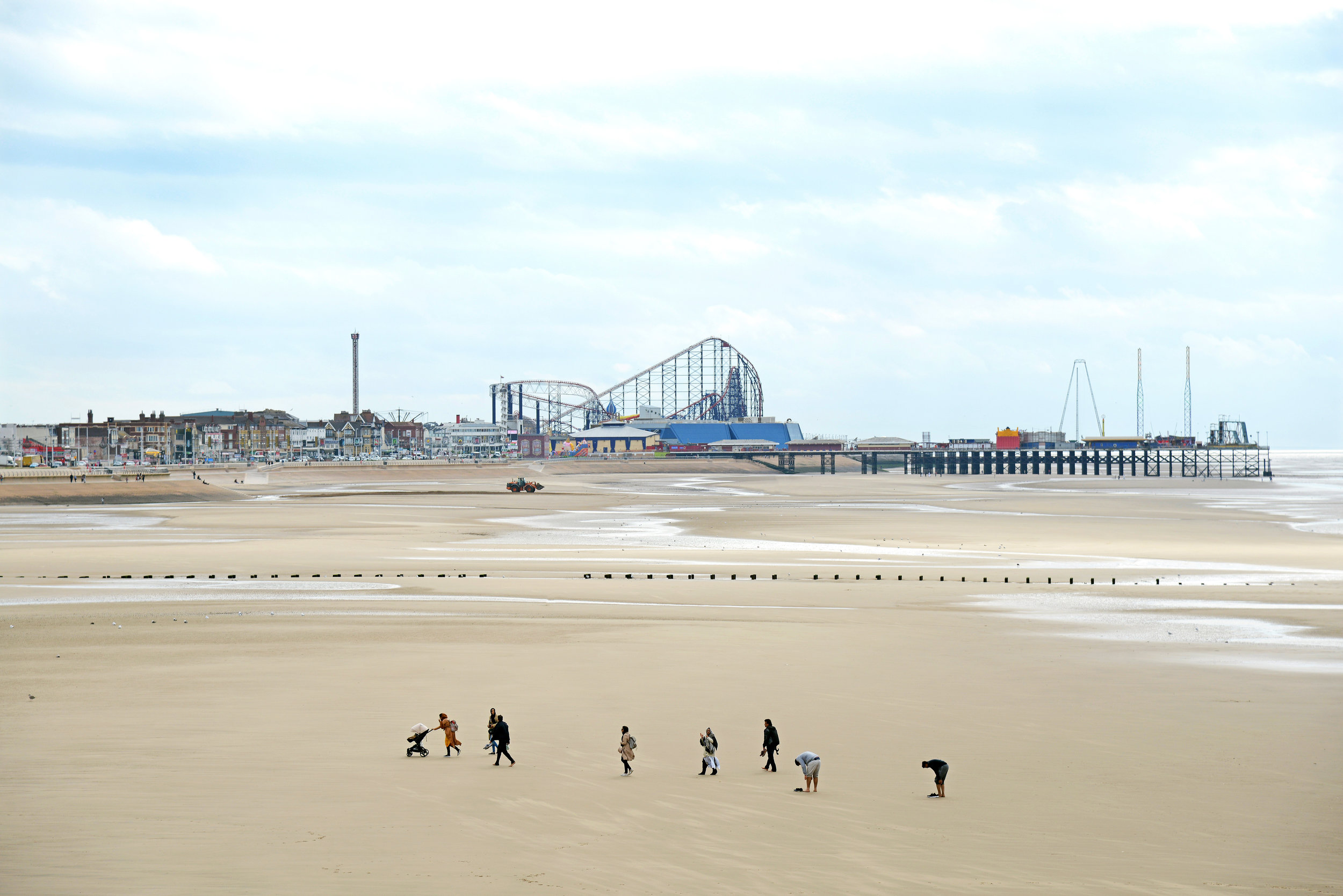 Autumn Visitors take the opportunity to walk on the beach during low tide with Blackpool�s Golden Mile as a backdrop.Photo by Howard Walker  12 September 2016