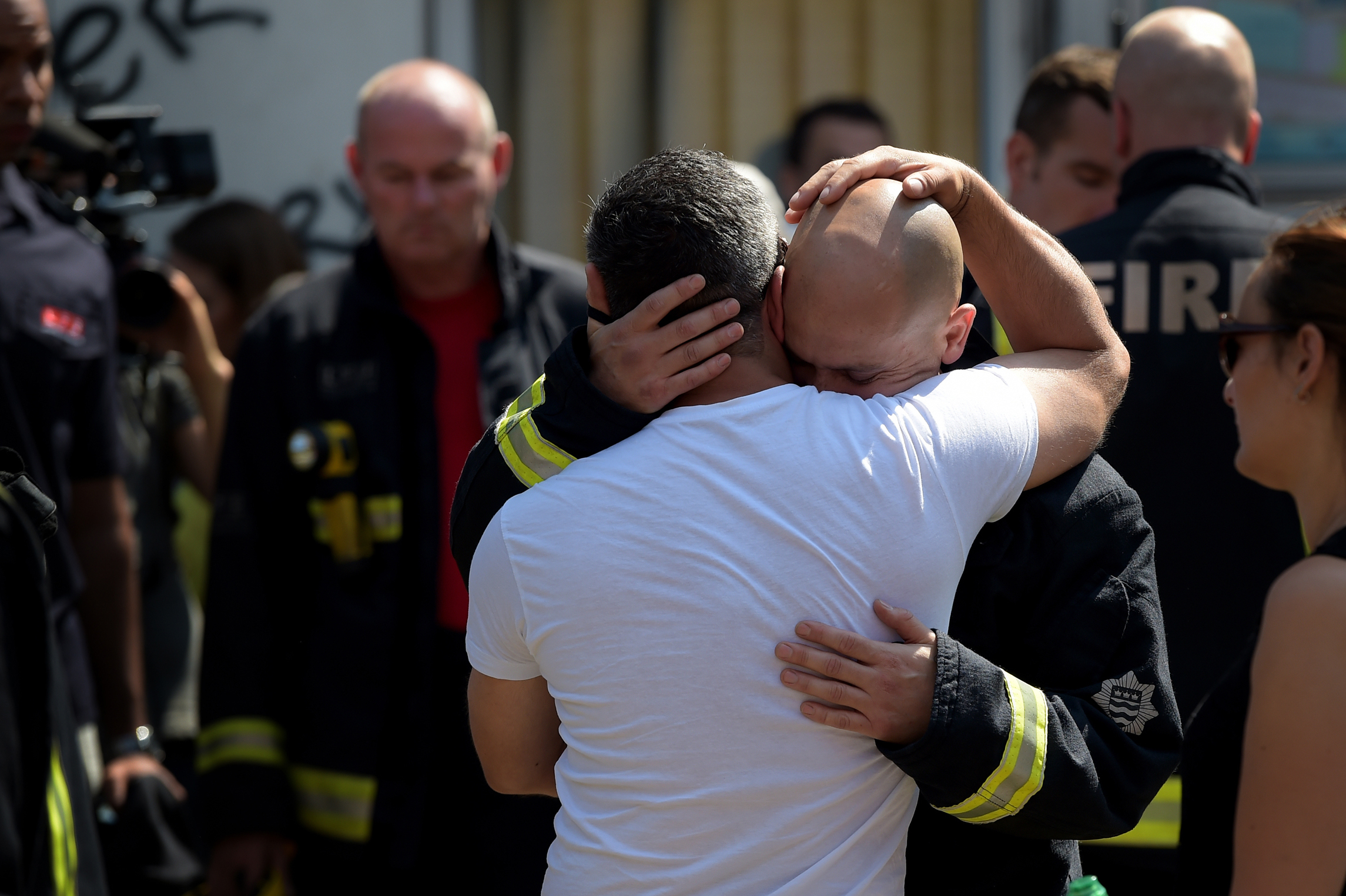 Members of the London Fire Brigade and local residents gather for a minute's silence remembering the victims of the Grenfell Tower Fire.Photo by James Veysey  19 June 2017