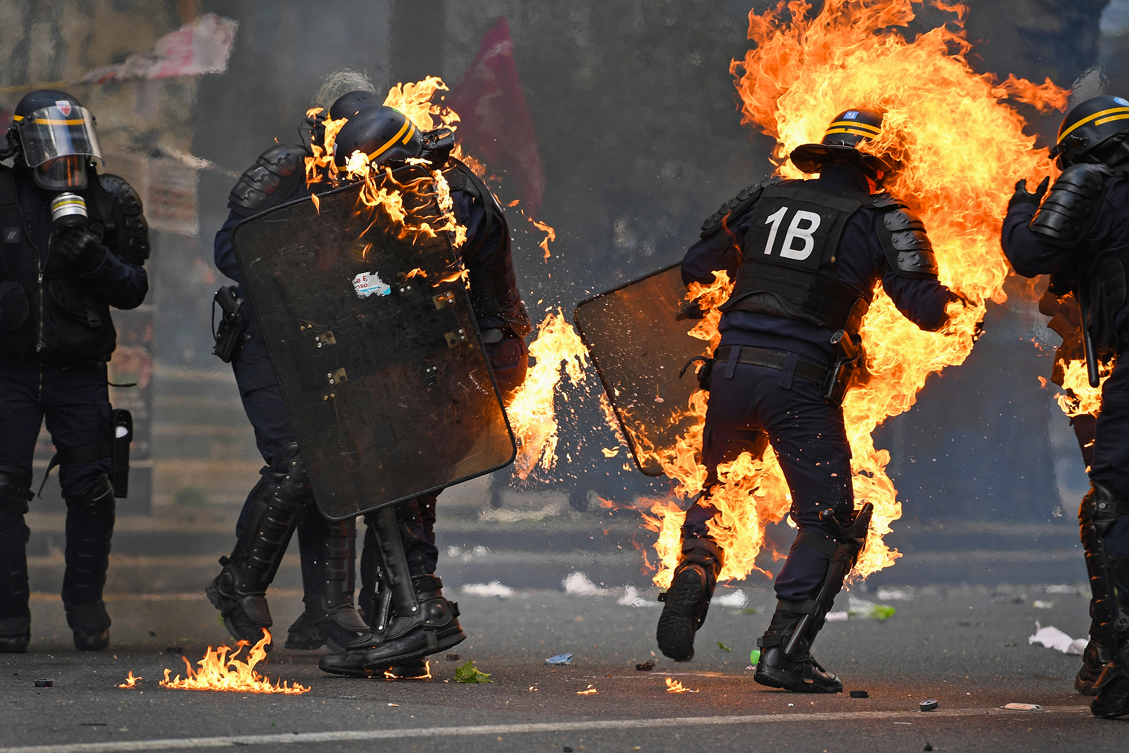 Police officers are hit by petrol bombs as demonstrators confront them on the annual May Day worker's march near Place de la Bastille in Paris.Photo by Jeff J Mitchell  01 May 2017
